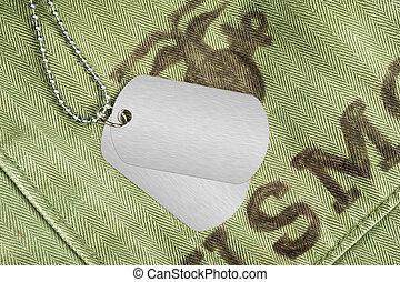 Dog tags on military uniform