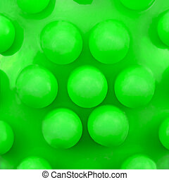 Dog teeth massage toy ball knobs pattern, large deailed green macro closeup, abstract plastic circles texture studio shot, canine dental care concept