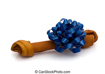 Dog Treat - A rawhide dog bone with a blue blow isolated on...