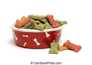 An isolated shot of a bowl full of dog treats.