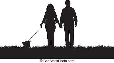 dog walking - a couple walking their dog