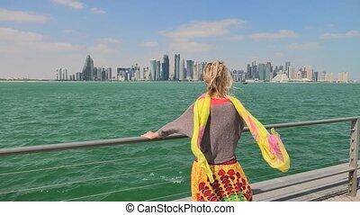 Doha Corniche seascape - Carefree woman enjoys the seascape...