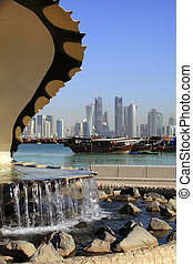 Doha fountain, harbour and skyline - The oyster and pearl...