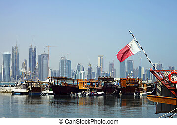 Doha harbour and towers - A view of the dhow harbour in...