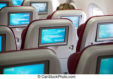 Economy class seats with entertainment system onboard.