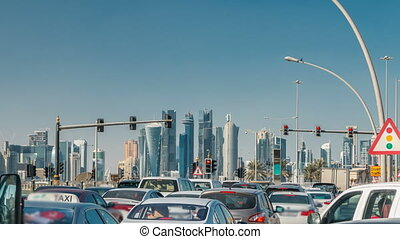 Doha skyline and traffic jam on the intersection timelapse...