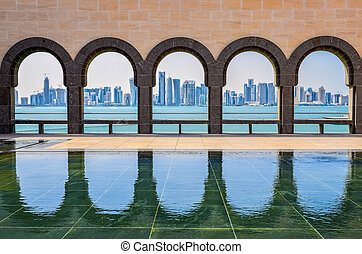 Doha skyline seen through the arches at the Museum of ...