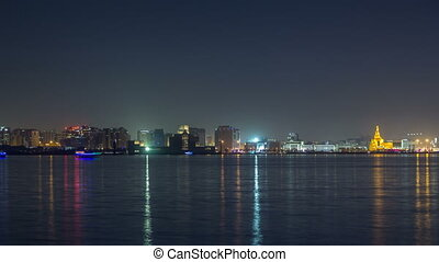 Doha skyline with the Islamic Cultural Center timelapse in...