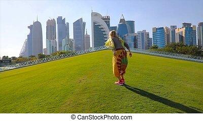 Doha skyline woman