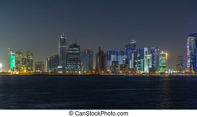 Doha skyscrapers in downtown skyline night timelapse, Qatar, Middle East