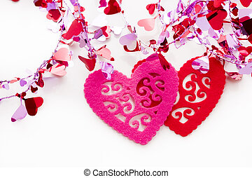 Doilies - Two heart shaped doilies on white background.