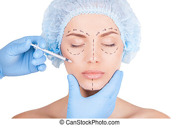 Doing a Botox injection. Beautiful young shirtless woman in ...
