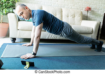 Doing an online exercise routine on a phone