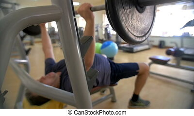 Doing bench pressing in the gym