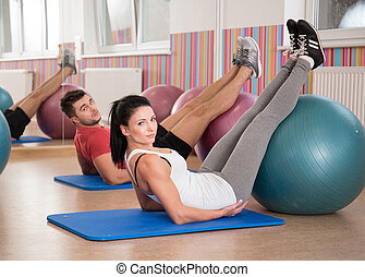 Doing crunches with fitness ball