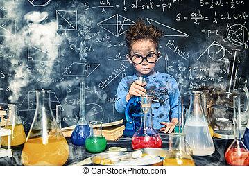 doing dangerous experiment - Little boy doing experiments in...
