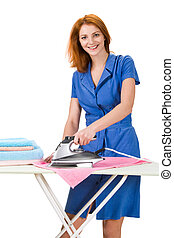 Doing domestic chores - Portrait of young female ironing ...