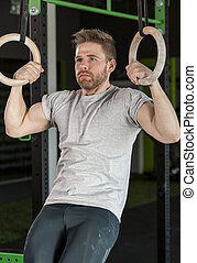 Doing exercise with gymnastics rings