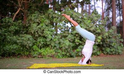 doing handstand yoga mediatation exercise