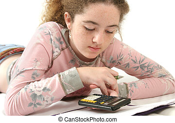 Doing Homework - A teenaged girl studying math, using a...