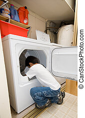 Doing household chores - Young independent asian boy doing...