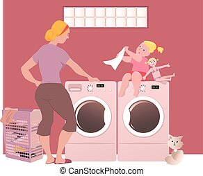 Doing laundry - A woman with her little daughter doing ...