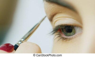 Doing make-up of female eye