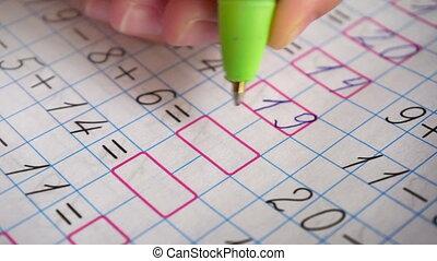 Doing math homework. Solves simple examples - Doing math...