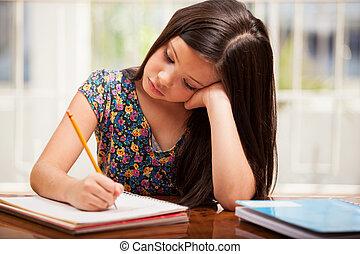 Doing some boring homework - Cute little brunette doing her...