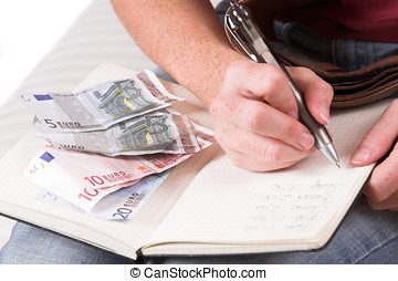 Doing the administration - Womanhand writing down the...