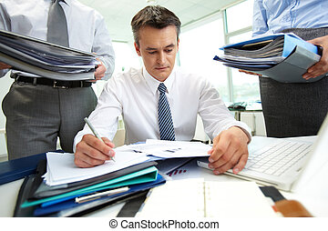 Doing work - Confident accountant doing financial reports ...