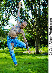 doing yoga in a park