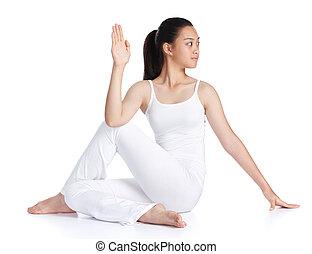doing yoga - female asian teenager exercising yoga against...