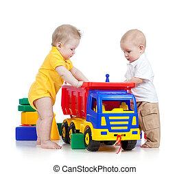 dois, pequeno, jogar crianças, com, cor, brinquedos