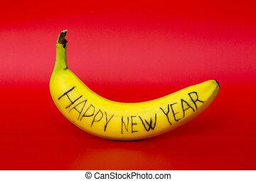 """dojrzały, banan, z, przedimek określony przed rzeczownikami, napis, """"happy, nowy, year"""", na, niejaki, czerwone tło"""