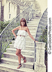 Dolce vita - Beautiful woman stepping down stair of the old ...