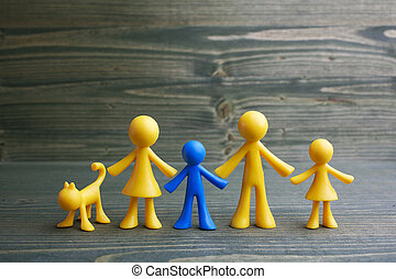 Doll family design with one different kid on wooden background. Autism symbol