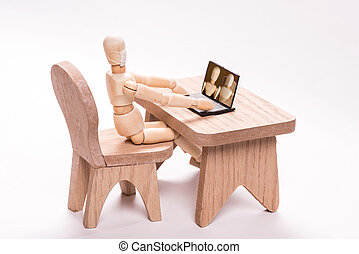 Doll holding a video conference - Sitting wooden doll ...