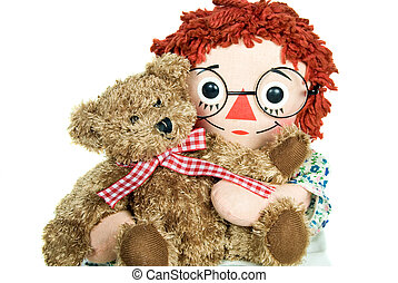 Doll hugging a brown teddy bear isolated on white.