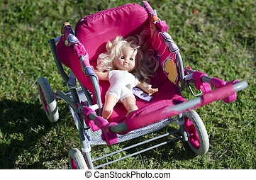 Doll in carriage - Blonde doll in a child carriage.