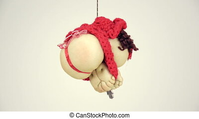 Doll lady in red hat is turning on the rope