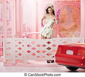 Doll like brunette in a doll house