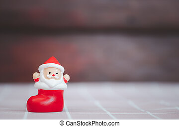 Doll Santa claus in the red sock. Merry christmas.