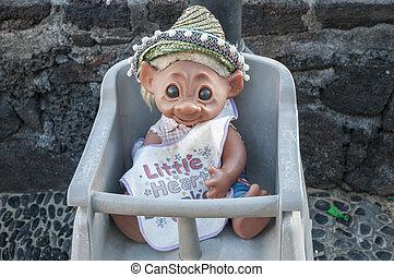 doll sitting