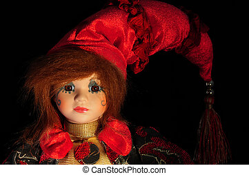 Doll - Ceramic doll isolated on black background.