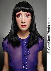 Doll - Portrait of beautiful brunette with fancy makeup