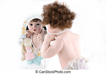 Doll with mirror - Porcelain doll with pearl beads looks in ...