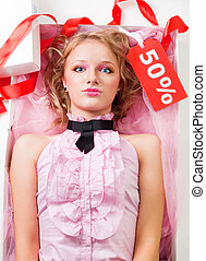 Doll with sale - Doll like woman with sale tag