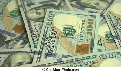 Dollar background rotating - American dollar bills...