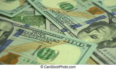 Dollar background rotating - American dollar bills...
